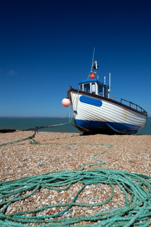 fishing cabin: abandoned fishing trawler on beach. ship on english south coast in dungeness Stock Photo