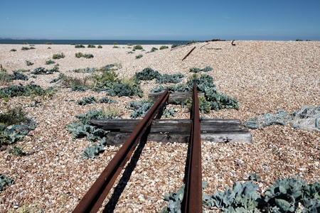 old railway tracks on beach, left over scrap from fishing industry Stock Photo - 16240611