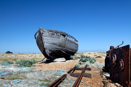 abandoned fishing trawler on beach. old ship wreck on english south coast in dungeness Stock Photo - 16240598