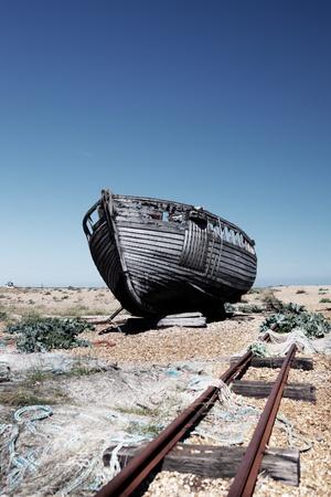 dungeness: abandoned fishing trawler on beach. old ship wreck on english south coast in dungeness