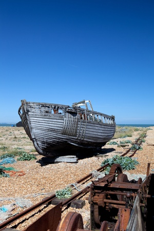 abandoned fishing trawler on beach. old ship wreck on english south coast in dungeness Stock Photo - 16240632
