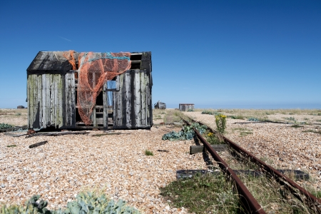abandoned fishing hut or shed. old wooden cabin on south coast of england in Dungeness Stock Photo - 16240689