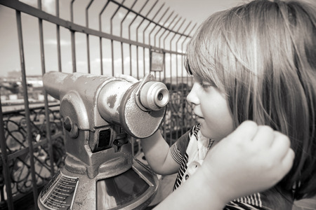 Sightseeing lookout binoculars with view of copenhagen. child tourist use telescope to see capital of denmark photo