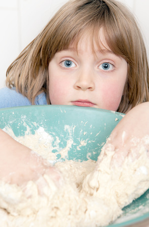 bread making with child kneading dough. cooking pastery product at home photo