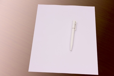 White pen paper wood background photo
