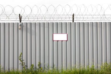 perimeter: Zinc Fence Barb high security Stock Photo