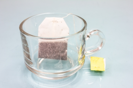 tea bag in cup on glass table photo