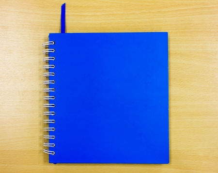 blue diary book on table office photo