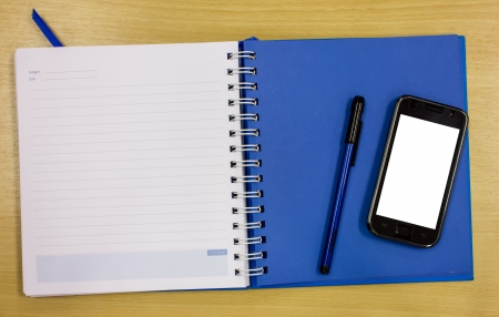 mobile phone blue diary book on table office Stock Photo - 16163801