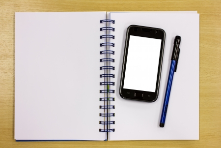 mobile phone blue diary book on table office Stock Photo - 16163752