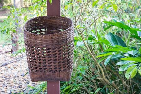 hand woven: Bamboo trash basket in garden Stock Photo