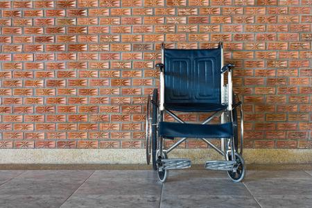 wheelchair rolls on the sidewalk Stock Photo - 27332292