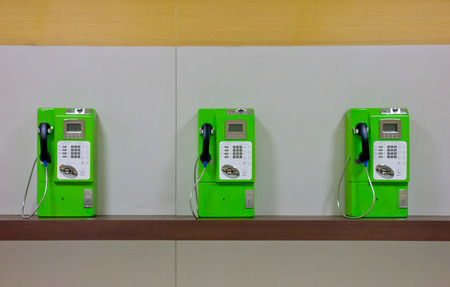 The roll of colorful public phones in the railway station photo
