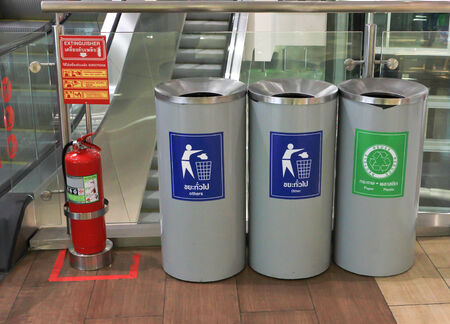Three bins recycling symbol in shopping mall photo