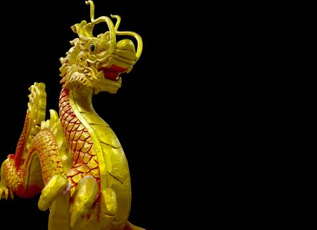 golden and red Chinese dragon on black background photo
