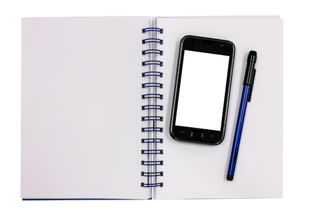 mobile phone and blue diary book on table photo