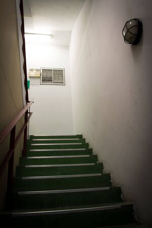 stairwell: Open green stairwell in a building Stock Photo
