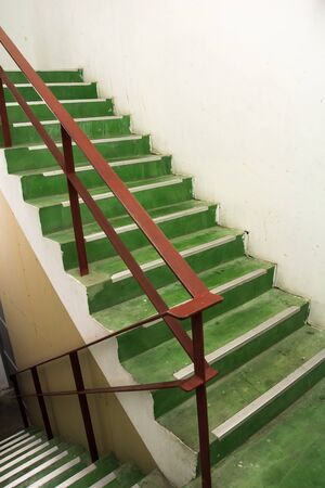 step well: Open green stairwell in a building Stock Photo