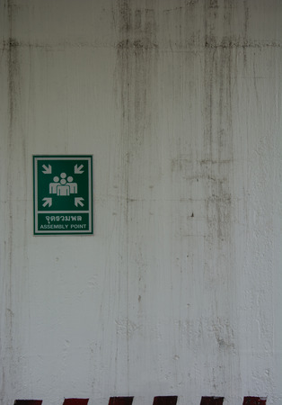 hazardous area sign: information plate of assembly station on the wall Stock Photo