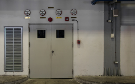 defense facilities: Grungy wall with door room control Stock Photo