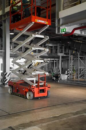 scissors: distribution warehouse hall with hydraulic scissors lift platform Stock Photo