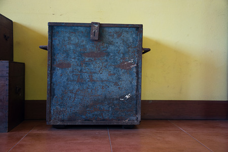 chest on an antique yellow wall  backgrounds Stock Photo