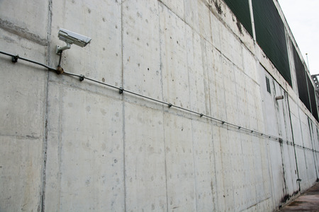 CCTV camera or surveillance operating with electric door in back Stock Photo