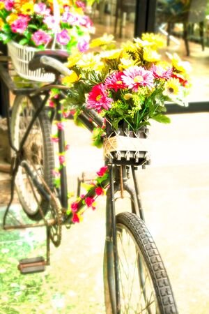 decorated bike: flowers on the Old bicycle Stock Photo