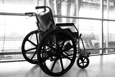 mobility nursing: Black and white Wheelchair service in airport terminal