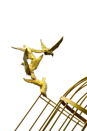 freeing: Gold Sculpture of a Dove Being Set Free