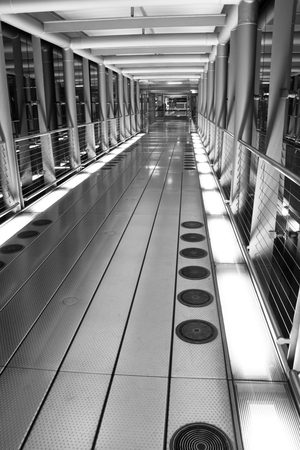 concourse: black and white Travelator Tunnel in Airport Concourse
