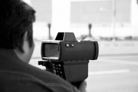 speeding: black and white catch speeding drivers with a radar gun
