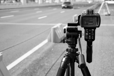 black and white catch speeding drivers with a radar gun Imagens - 44024948