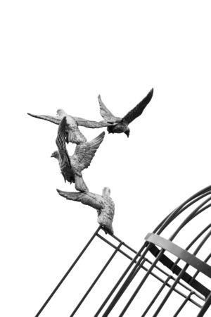 freeing: Black and white gold Sculpture of a Dove Being Set Free