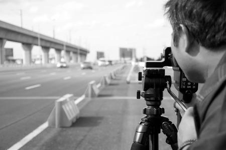 Black and white catch speeding drivers with a radar gun Imagens - 42875670