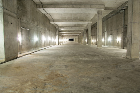 Empty industrial garage room interior with concrete floor and wall background Editorial