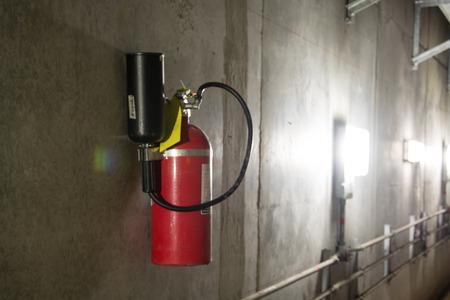 dimly: Fire extinguisher in dimly lit corridor Fire safety underground Stock Photo
