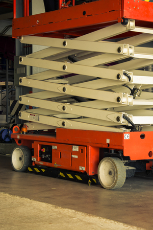distribution warehouse hall with hydraulic scissors lift platform, vintage color style