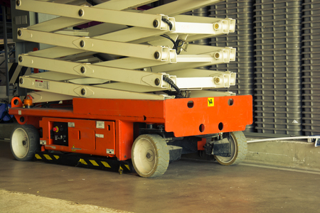 color distribution: distribution warehouse hall with hydraulic scissors lift platform, vintage color style