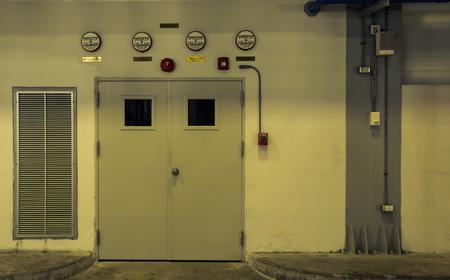 room door: Grungy wall with door room control, vintage color style