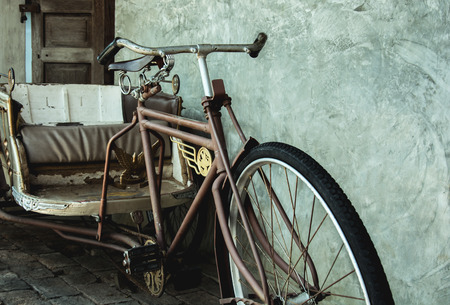 antique tricycle: Old three-wheeler,Thailand tricycle in vintage style, vintage color style