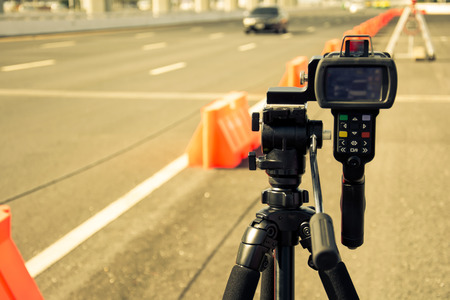 traffic officer: catch speeding drivers with a radar gun, vintage color style Stock Photo