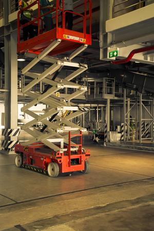 scissor: distribution warehouse hall with hydraulic scissors lift platform, vintage color style