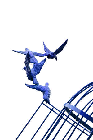 freeing: colorful Sculpture of a Dove Being Set Free Stock Photo