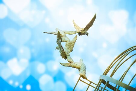 freeing: gold Sculpture of a Dove Being Set Free Stock Photo