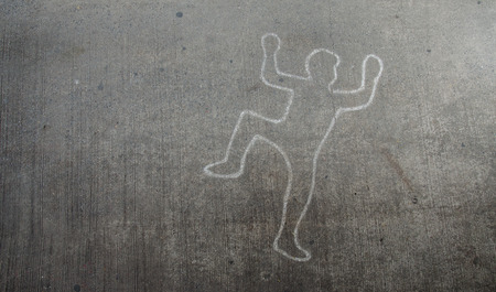 Crime scene chalk line of an auto accident with tire skid marks leading over the body.