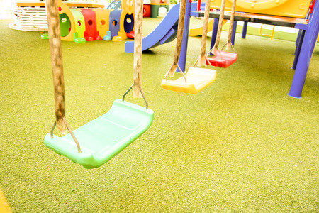 jungle gyms: Empty chain swings on summer kids playground, vintage color style