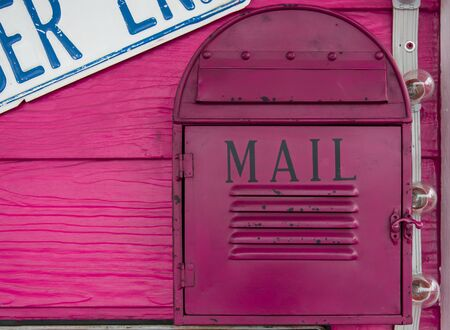 vintage mailbox on wood wall