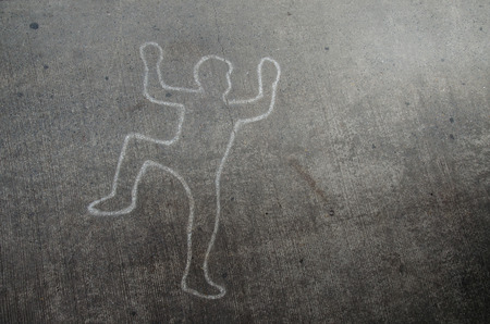 tire marks: Crime scene chalk line of an auto accident with tire skid marks leading over the body.