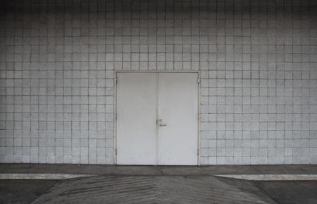 defense facilities: steel door and concrete surrounding.